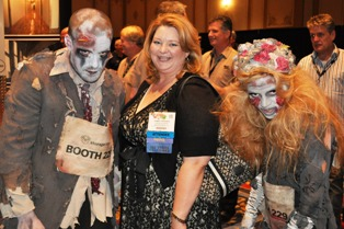 Storage.com zombies pose with and ISS Expo attendee on the show floor.