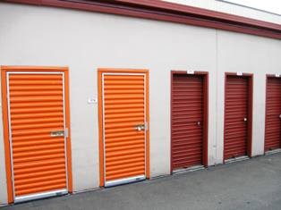 Janus International replaced this facility's existing red doors with shiny new orange ones. Replacing unit doors can give an older facility a fresh look.