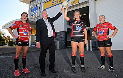 Storage King CEO Robin Greenwood (second from left) celebrates the company's sponsorship with players of the Gloucester-Hartpury Women's Rugby Football Club.