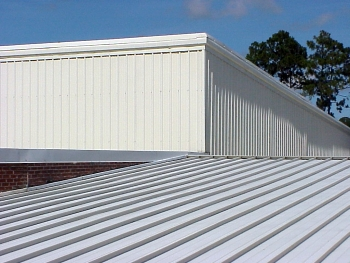 A light-colored metal-panel roof system is reflective to reduce heat gain. Concealed clips and fasteners are used to allow thermal expansion and contraction and eliminate exposed fasteners that may become a maintenance concern.