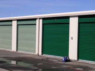 Properly restored self-storage doors making an amazing improvement to a facility's curb appeal.