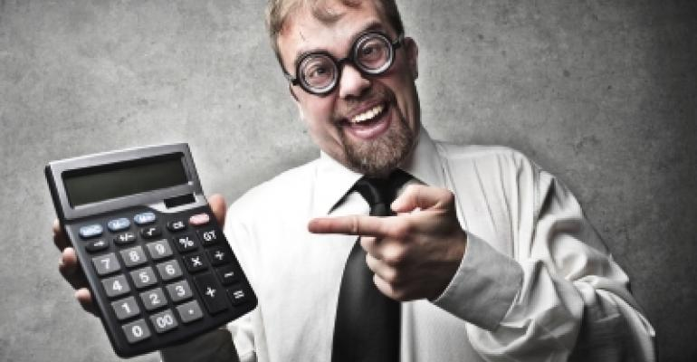 Man With Dorky Glasses and Calculator