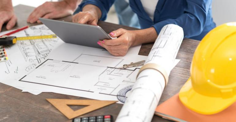 Architect designing with tablet