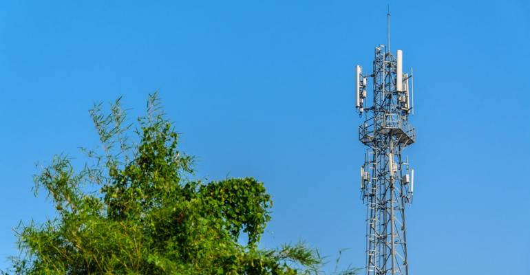 Cell tower with trees