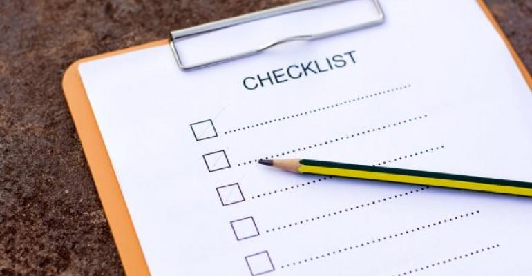 Checklist on clipboard with pencil