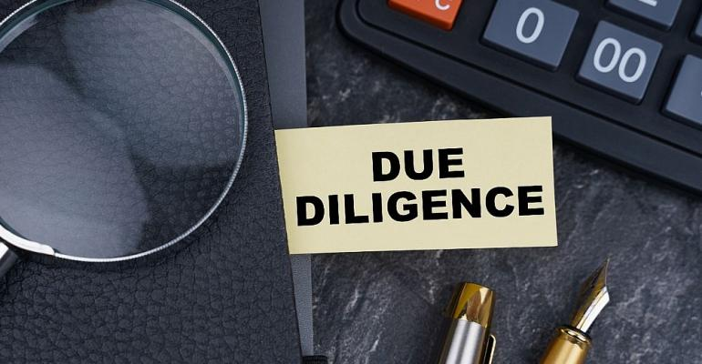 Due-Diligence-Calculator-Magnifying-Glass.jpg