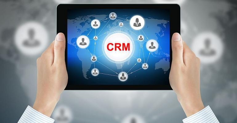 Hands-Tablet-CRM-Tech.jpg