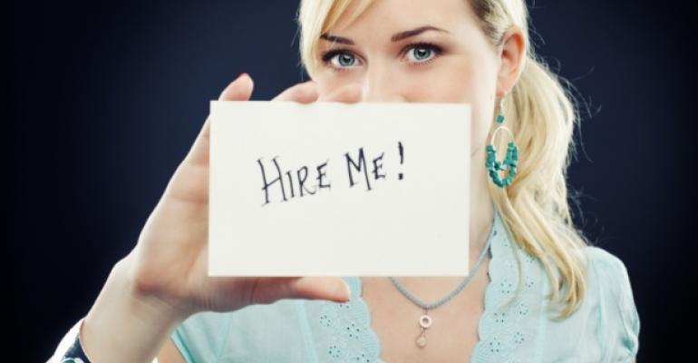Woman with Hire Me sign