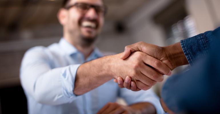 Man-Smile-Handshake.jpg