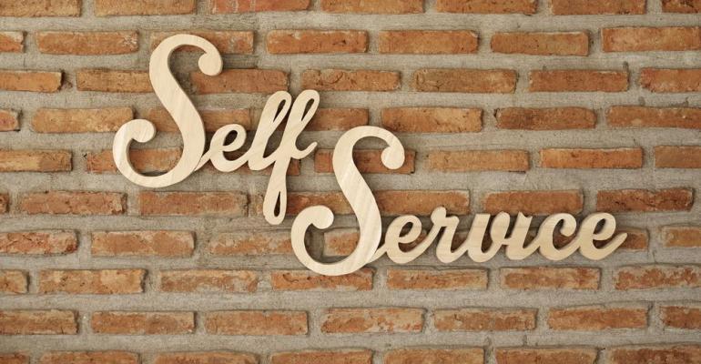 Self-Service signage on brick wall