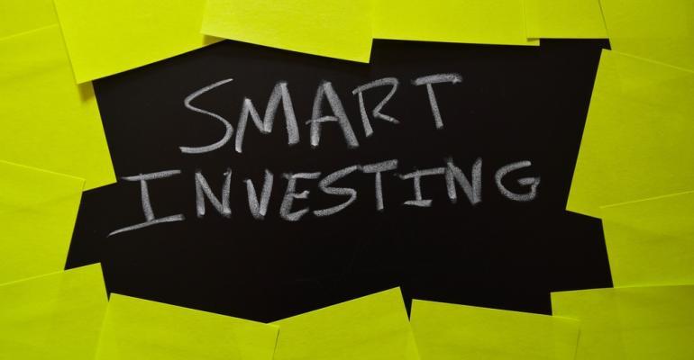 Smart Investing Words on Blackboard