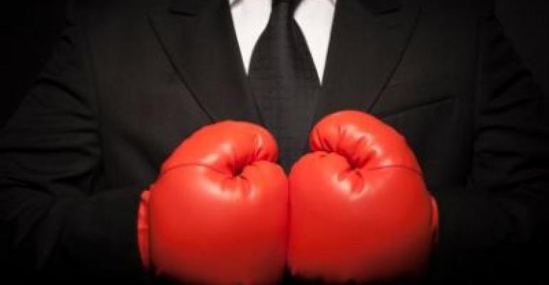 Man in suit with boxing gloves